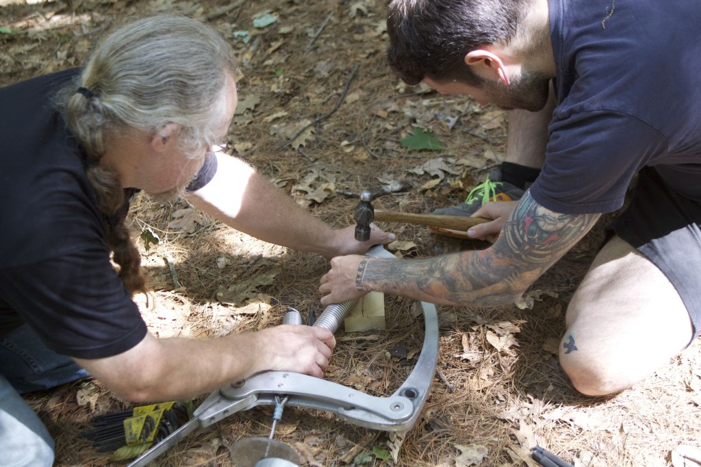 Ken and Joseph installing a new spring.